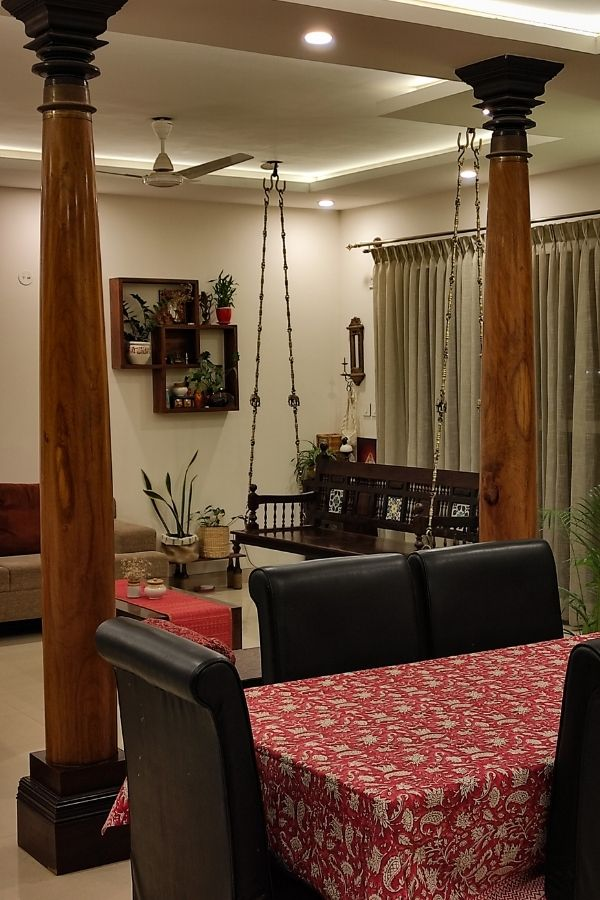 8ft pillars from Tamil Nadu installed in living room | Home Tour: A beautiful Antique Modern home in Bangalore