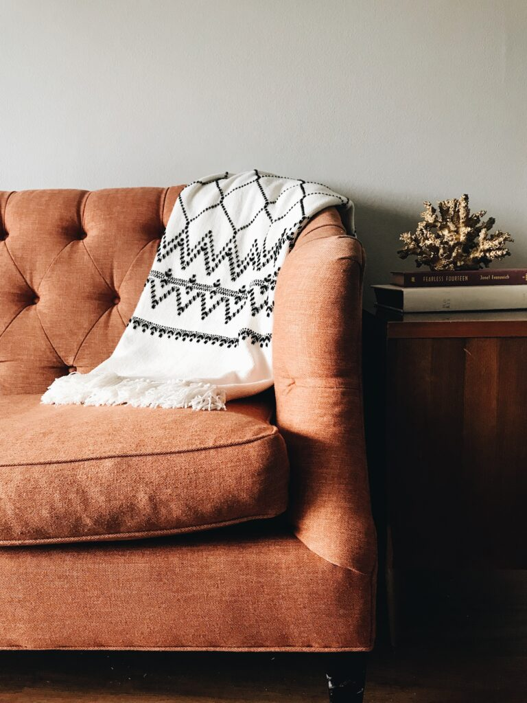 A throw is a must for monsoon couch styling  Monoon decor and living edit