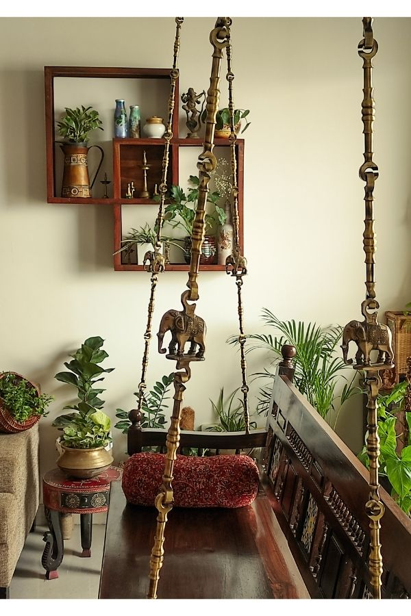 A healthy indoor garden and swing in living room | Home Tour: A beautiful Antique Modern home in Bangalore