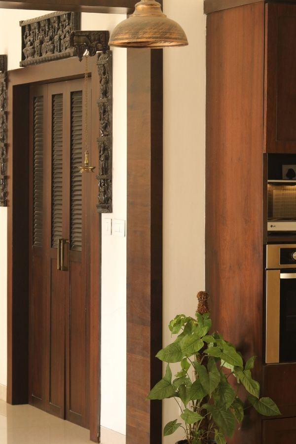 A vintage teak door | Home Tour: A beautiful Antique Modern home in Bangalore