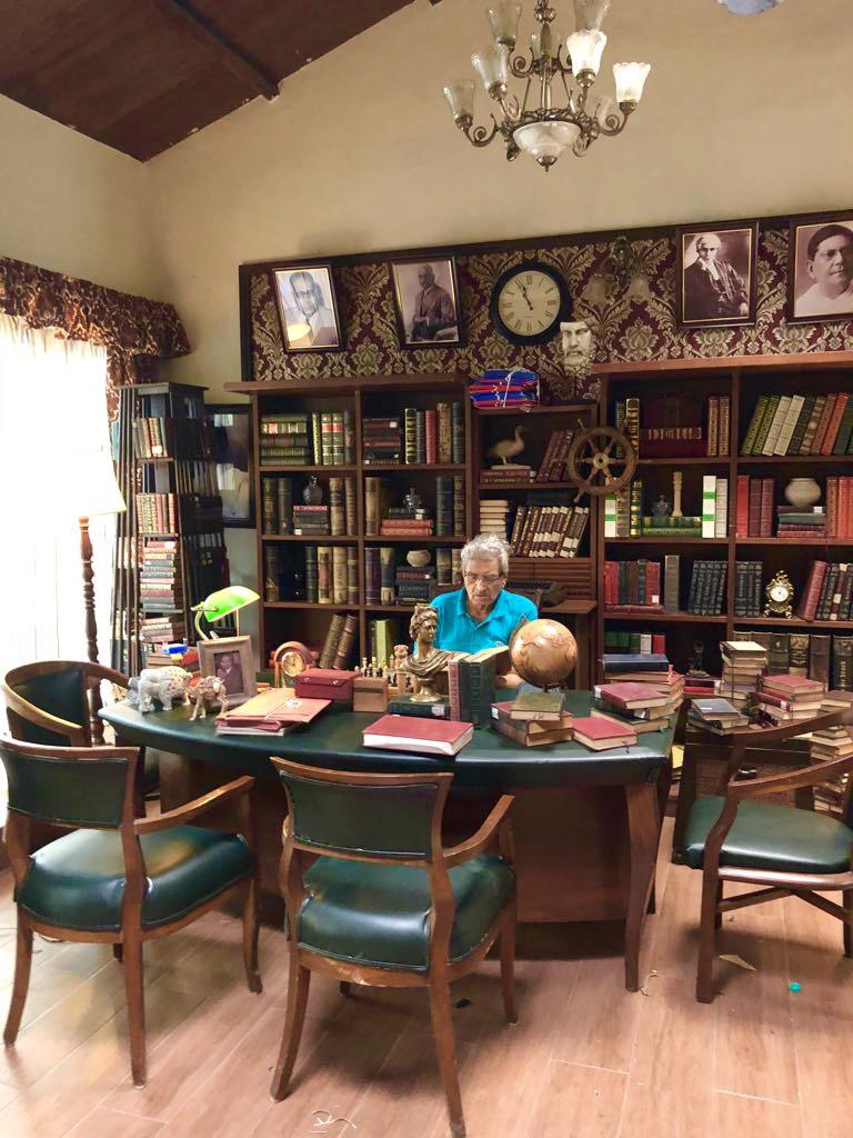 Villa Rashmi - A Heritage Gem in Mumbai   Vintage books on old wooden shelf and Haresh Patel at villa office   TheKeybunch decor blog
