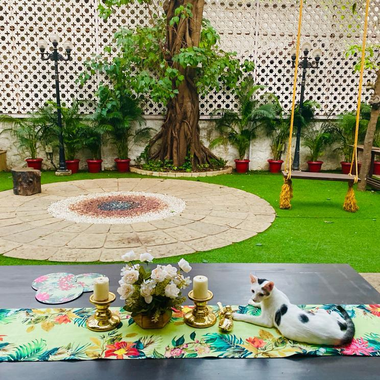 Villa Rashmi - A Heritage Gem in Mumbai   The table runner was decorated with fresh flowers, candle stand holder and a cute cat in the backyard garden   TheKeybunch decor blog