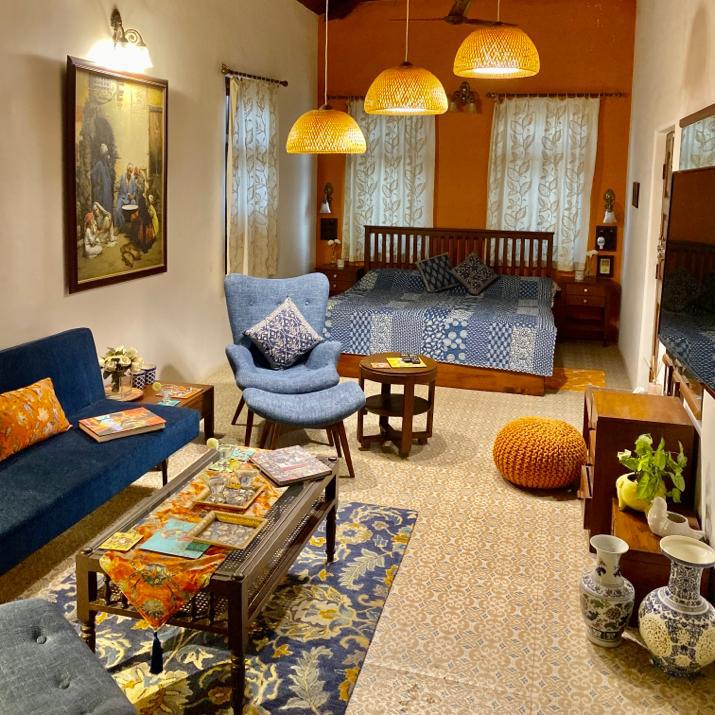 Villa Rashmi - A Heritage Gem in Mumbai   The private apartment was decorated with chairs, fresh flowers, books on the table and bed for relaxing   TheKeybunch decor blog