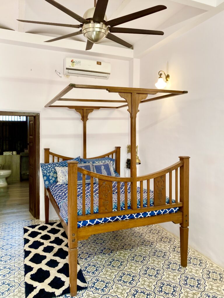 Villa Rashmi - A Heritage Gem in Mumbai   Indian antique bed and handpainted floor tiles at private bedroom   TheKeybunch decor blog