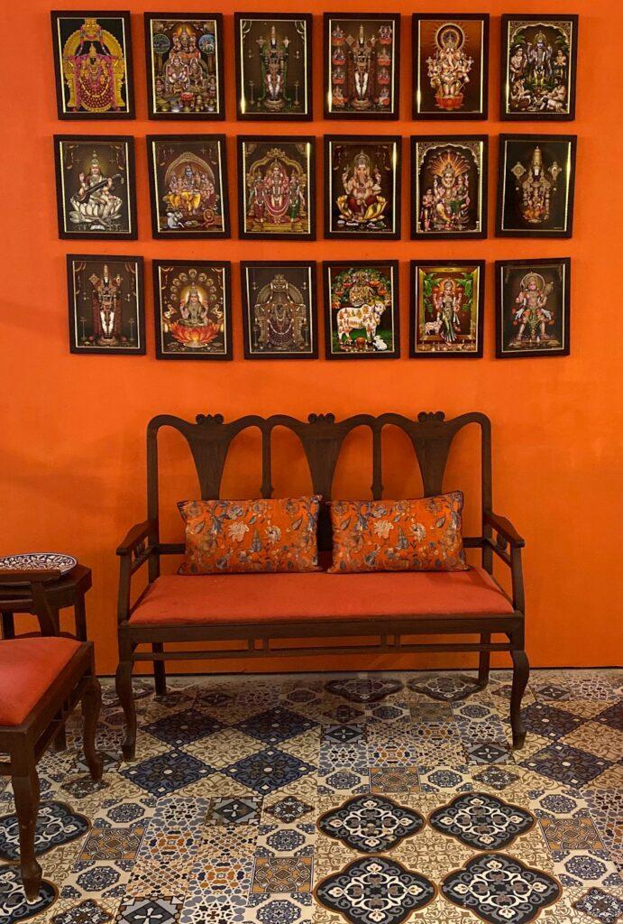 Villa Rashmi - A Heritage Gem in Mumbai   The wall frames of various hindu gods and italian mosaic tile at the room   TheKeybunch decor blog