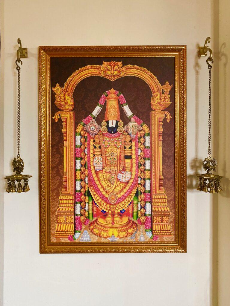 Villa Rashmi - A Heritage Gem in Mumbai   Hanging brass diya lamp and hindu god frame at corner of the room   TheKeybunch decor blog