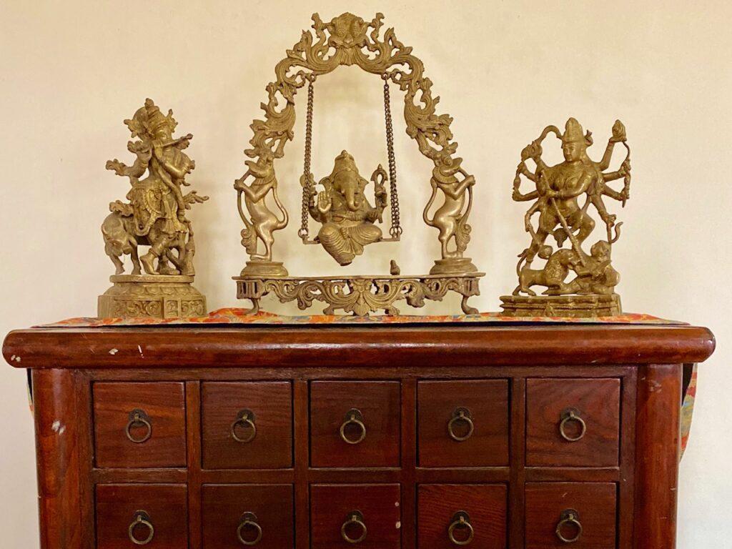 Villa Rashmi - A Heritage Gem in Mumbai   Brass hindu god idols on top of the cabinet   TheKeybunch decor blog