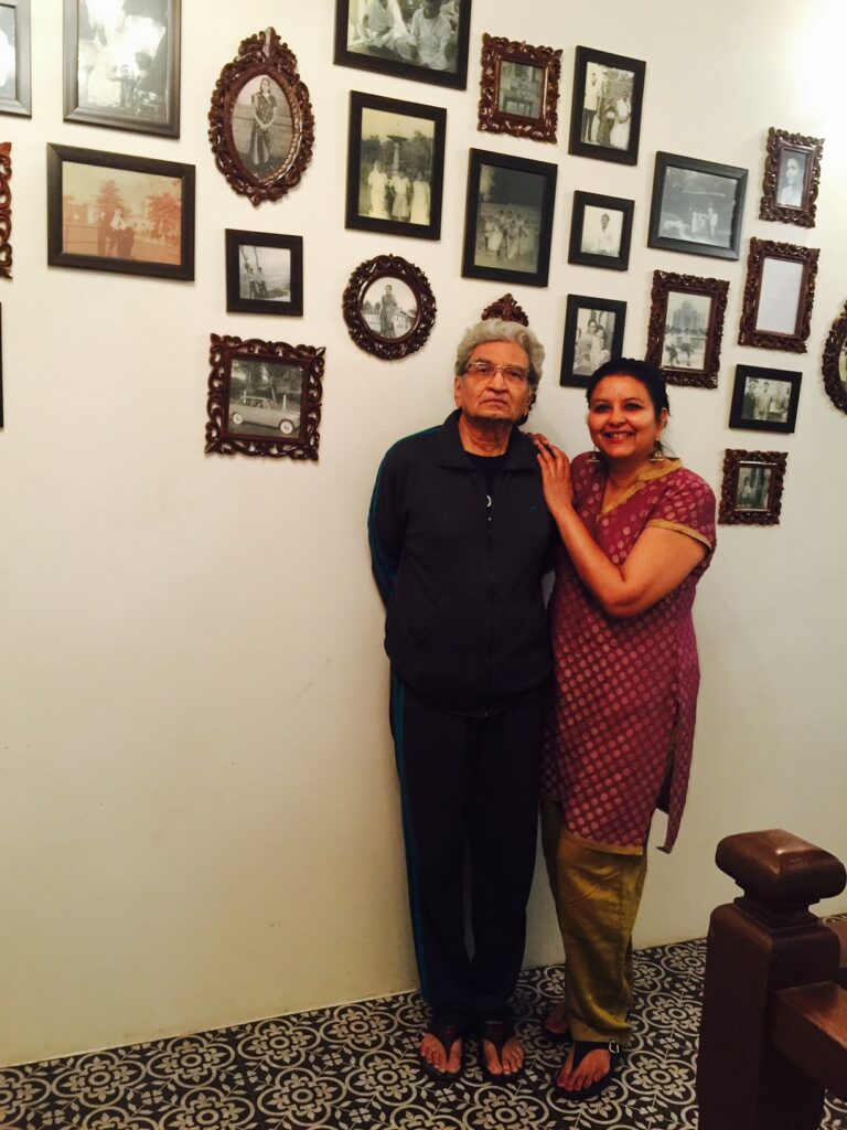 Villa Rashmi - A Heritage Gem in Mumbai   Deval Patel with her dad Haresh Patel in front of the old family photographs   TheKeybunch decor blog