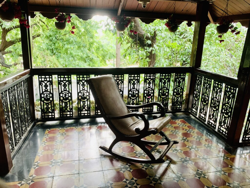 Villa Rashmi - A Heritage Gem in Mumbai   Old wooden rocking chair on the balcony of the house   TheKeybunch decor blog