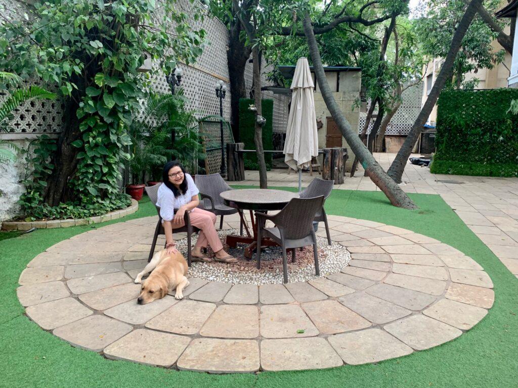 Villa Rashmi - A Heritage Gem in Mumbai   Deval relaxing in the expansive backyard at Villa Rashmi   TheKeybunch decor blog