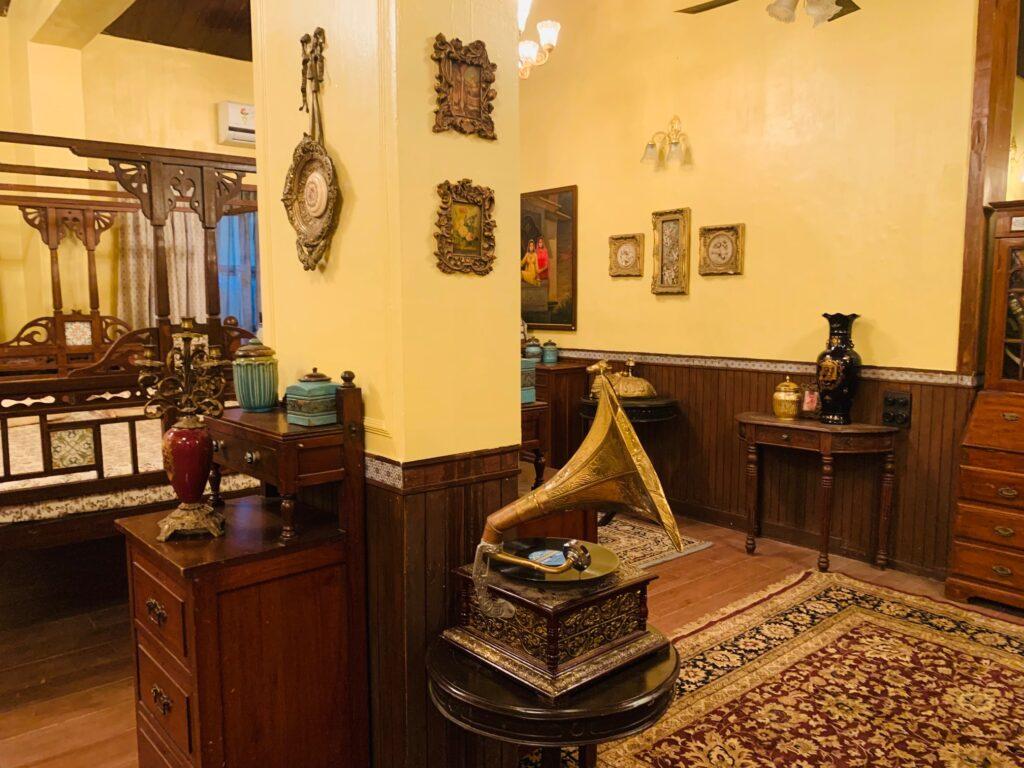 Villa Rashmi - A Heritage Gem in Mumbai   Gramophone music player with brass wall decoration at the bedroom corner   TheKeybunch decor blog