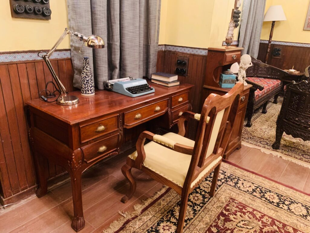 Villa Rashmi - A Heritage Gem in Mumbai   Typywriter, table lamp and book on top of console table at the corner of the bedroom   TheKeybunch decor blog