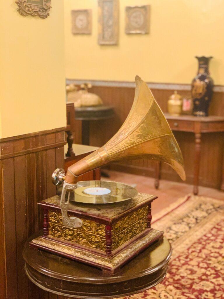 Villa Rashmi - A Heritage Gem in Mumbai   Brass gramophone music player on top of table at the bedroom corner   TheKeybunch decor blog