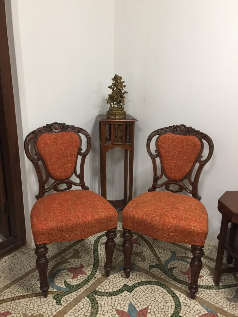 Villa Rashmi - A Heritage Gem in Mumbai   Antique chairs and brass idol on top of the table   TheKeybunch decor blog
