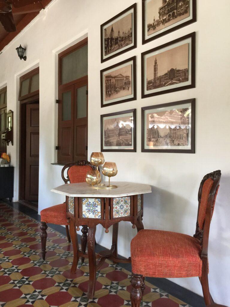 Villa Rashmi - A Heritage Gem in Mumbai   The verandah decorated with wall frames and antique furniture   TheKeybunch decor blog   TheKeybunch decor blog