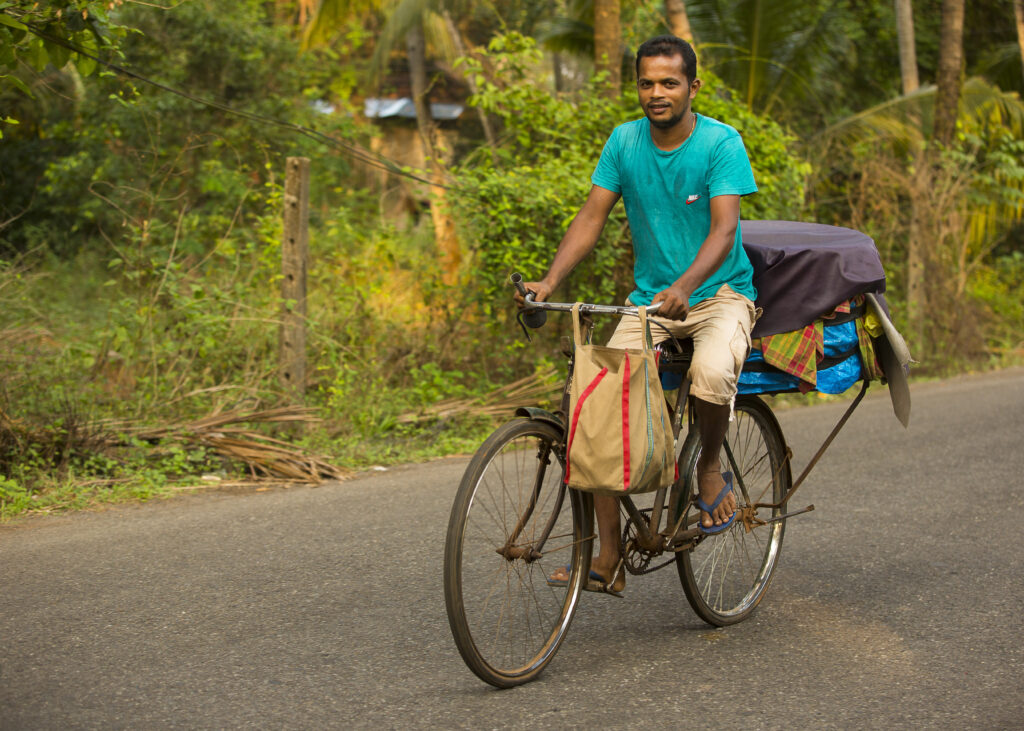 Betalbatim in Goa, India   Julio the paodar (bread-seller) on his bicycle, alert the villagers about his arrival   TheKeybunch decor blog
