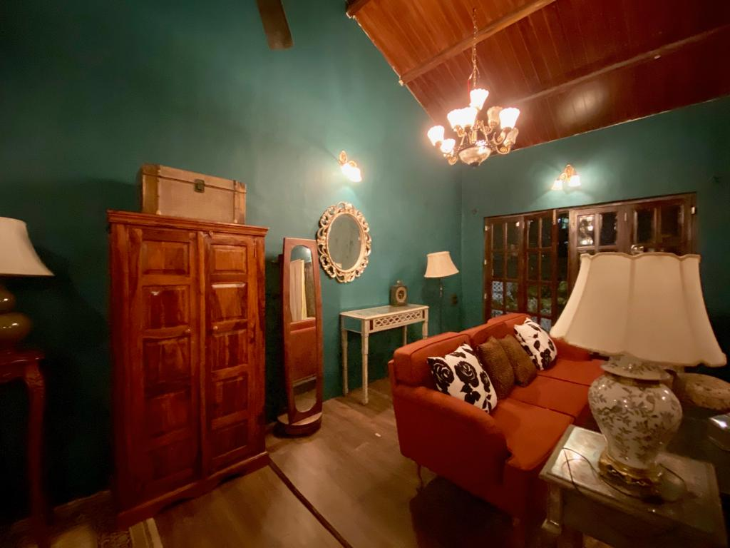 Villa Rashmi - A Heritage Gem in Mumbai   The corner of the room was decorated with decorative mirror frame, wooden cabinet, standing mirror and table lamp   TheKeybunch decor blog