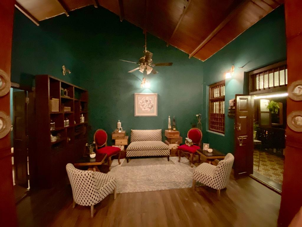 Villa Rashmi - A Heritage Gem in Mumbai   The living area was decorated with chairs, wooden shelf and wall frame   TheKeybunch decor blog