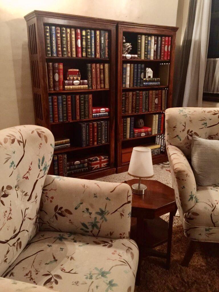 Villa Rashmi - A Heritage Gem in Mumbai   Old vintage books on wooden shelf at the private residence   TheKeybunch decor blog