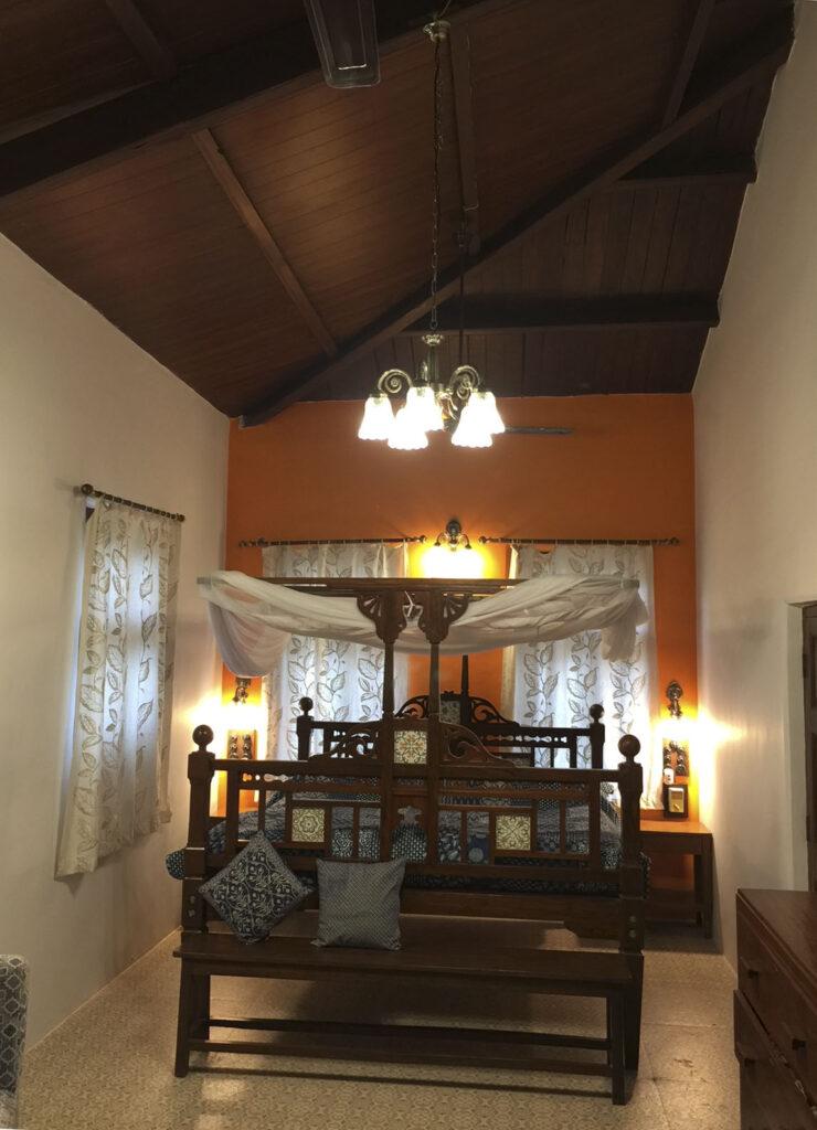Villa Rashmi - A Heritage Gem in Mumbai   A restored bedroom depicting the lovely wooden sloping cielings at Villa Rashmi   TheKeybunch decor blog