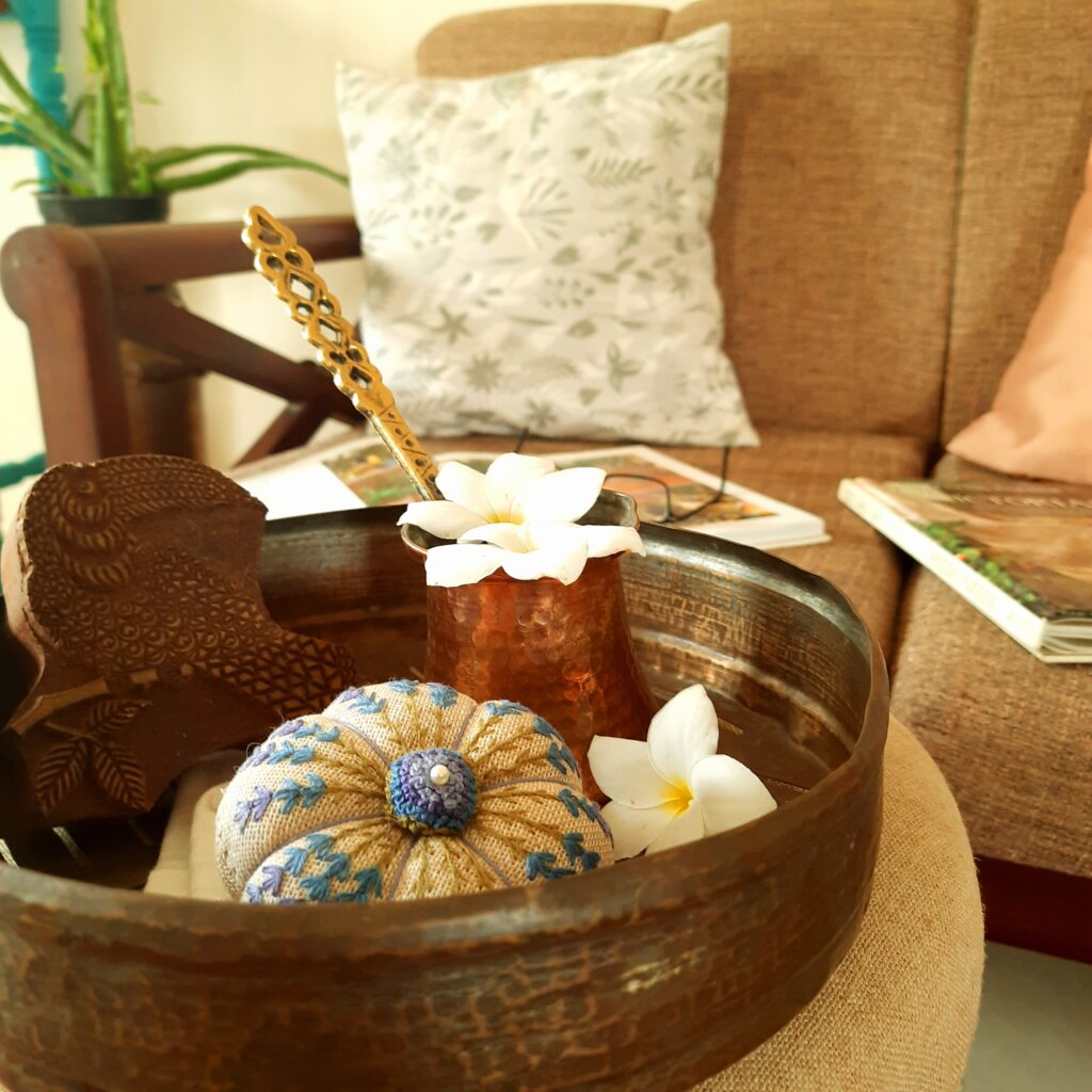 Fall Decor in India - Autumn Season | The beautiful embroidered pieces in brass trays at center table in the living room
