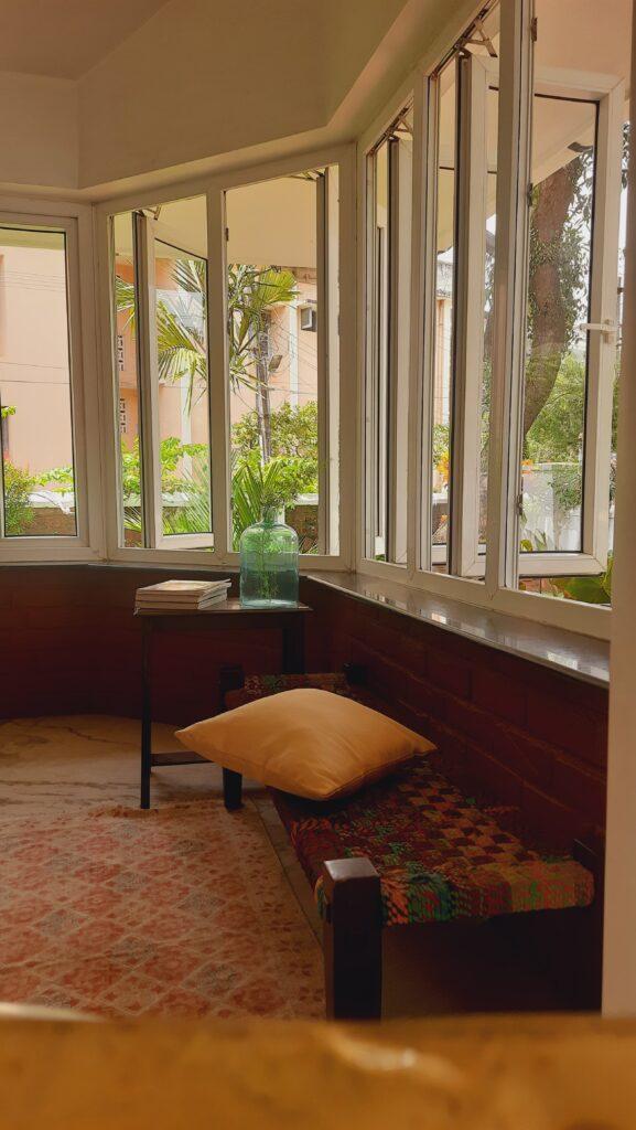 Fall Decor in India - Autumn Season | Green bottle on top of the table at the verandah