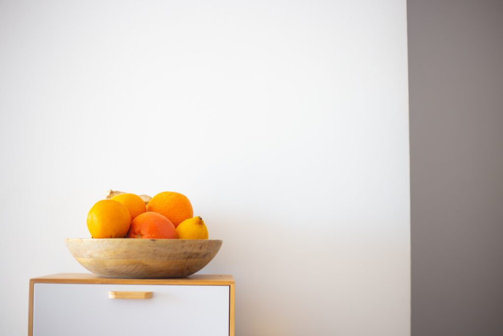 Fall Decor in India - Autumn Season | A bowl of citrus fruits on table top