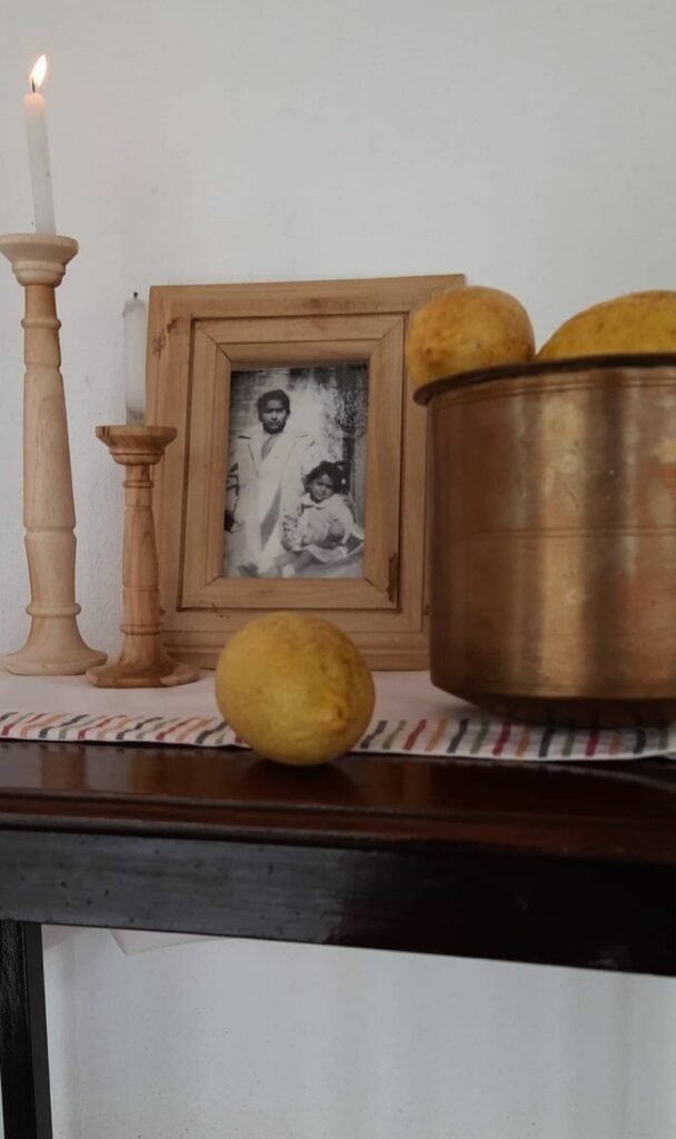 Fall Decor in India - Autumn Season | The top table has been decorated with wooden candle stands, wooden frames and brass utensil with fruits on it