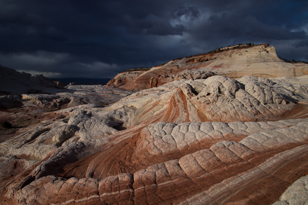 landscape photography of White Pocket with a stormy sky