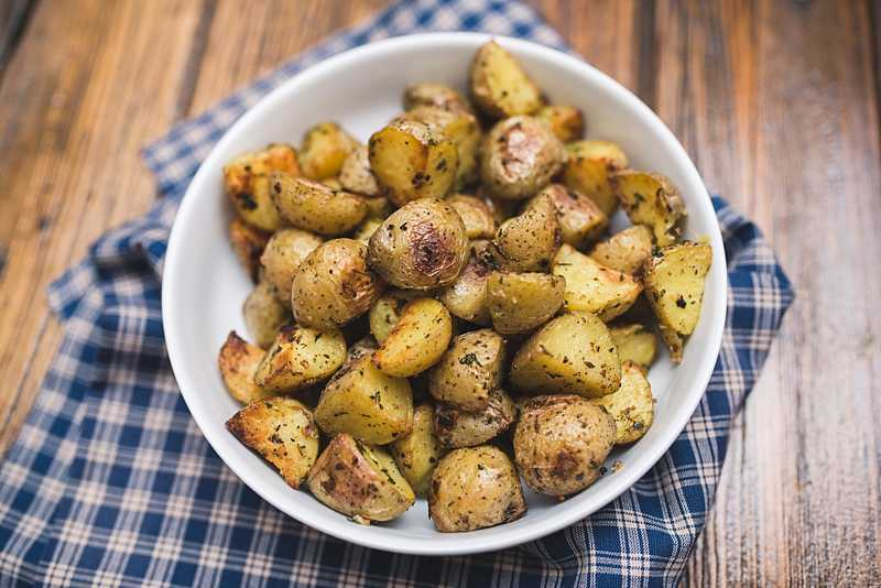 These roasted Yukon gold potatoes are crispy on the outside & soft and creamy on the inside. They are beautifully seasoned and pair well w/ everything. | FirstandFull.com