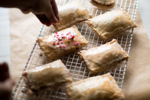 These homemade pop-tarts are flavorful and made with REAL ingredients. I stuck with a homemade pie crust, easy cherry berry jam and light glaze.