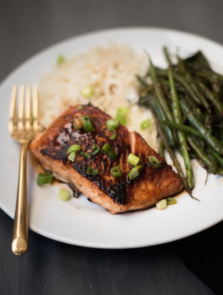 An easy 5 ingredient honey Sriracha salmon dish. A little sweet, a little spicy, and really tasty! The salmon cooks fast on the stove and is great served over rice with your favorite green vegetable. | Firstandfull.com
