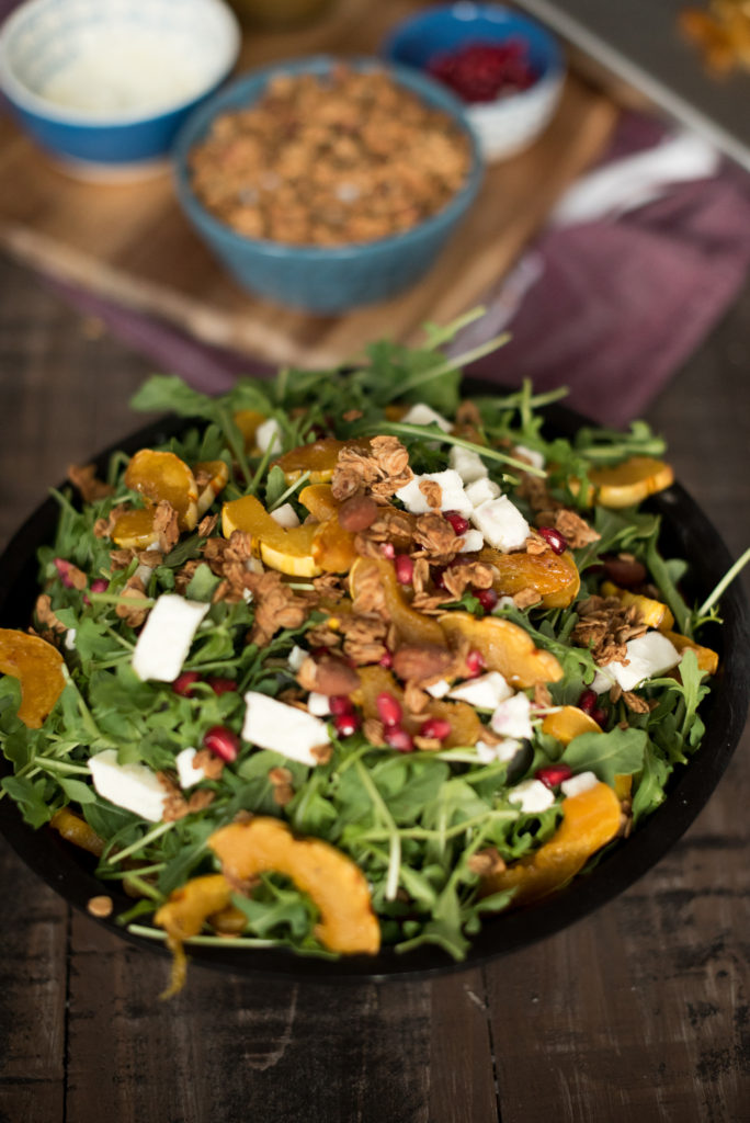 Delicious Fall Inspired Salad: Roasted Delicata Maple Salad with roasted squash, pomegranate, feta, granola, and a delicious apple cider vinaigrette.