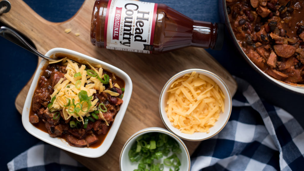 BBQ Chili with ground beef, smoked sausage, and chopped brisket will really elevate your next tailgate. Addition of bbq sauce adds a new depth of flavor!