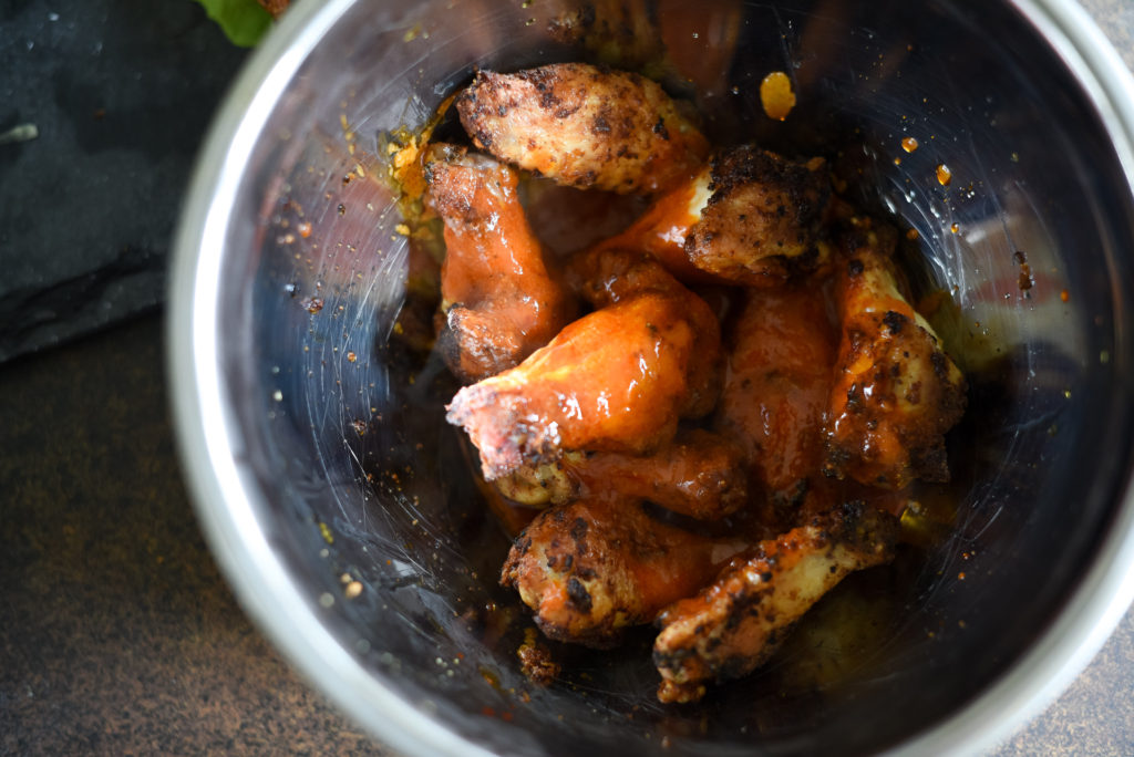 Traditional hot wings with a little zing! Crispy Lemon Pepper Buffalo Wings seasoned with lemon garlic seasoning, tossed with a traditional buffalo wing sauce served with a squeeze of lemon juice.