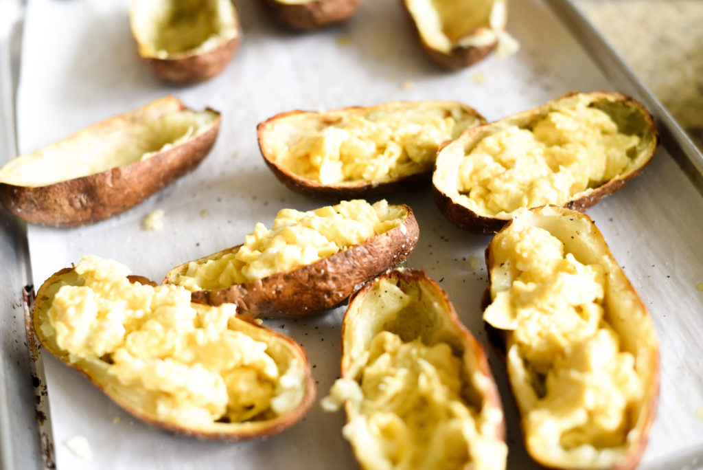 A fun, hand held breakfast option: Crispy Breakfast baked potato skins topped with scrambled eggs, garlicky spinach, chopped, crispy bacon, and a dollop of fresh pesto.Plus, tons of ways to customize and change things up!