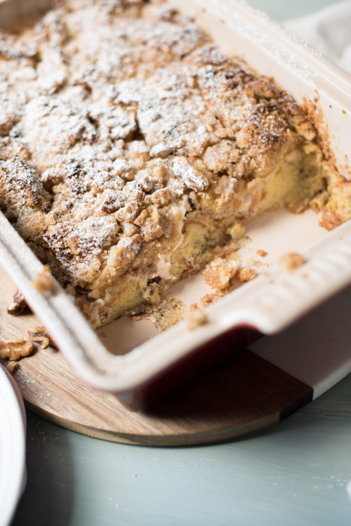 This stuffed cinnamon roll French toast has all the flavors of a homemade cinnamon roll but without all the effort. Sweet, eggy custard poured over brioche bread, stuffed with a sweet cream cheese, topped with a crunch streusel. Heaven in a casserole dish!