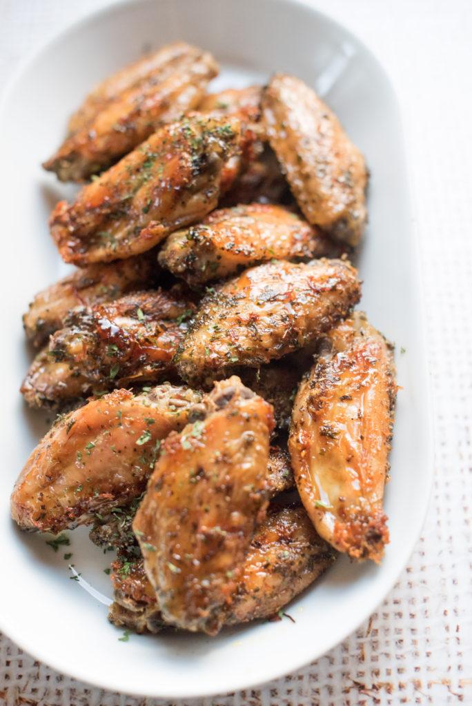 Italian Honey Baked Chicken Wings in a white platter