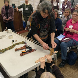 Linda Hendrickson demonstrating cord making