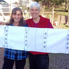 Chanuka placemats by Sheila O'Hara (right) and her student Suzanne Britz