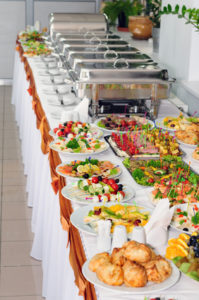 chafing dishes at table ready for wedding catering