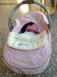 """""""Shower cap"""" style car seat cover (with blanket between cover and baby- on top of harness) (photo credit: Saara Moskowitz)"""