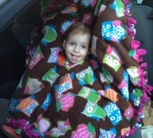 Fleece poncho in use over car seat/harness (photo credit: Saara Moskowitz)