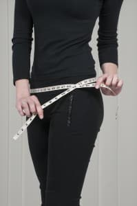 Woman measuring self