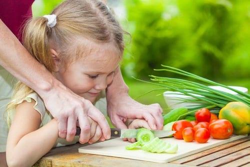 Little Girl Chops Vegetables