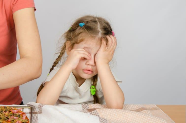 Little Girl wearily rubbing her eyes