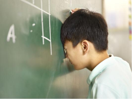 Math frustration boy with dyscalculia