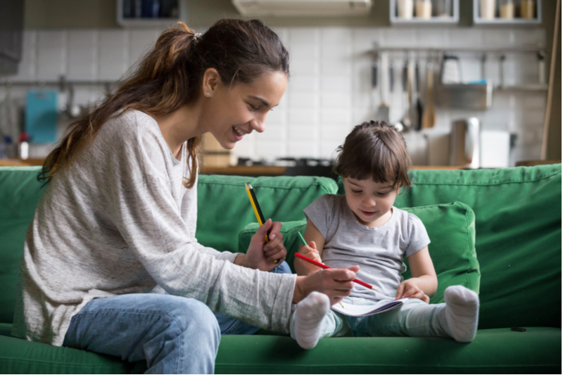 Babysitter and child do drawing activity