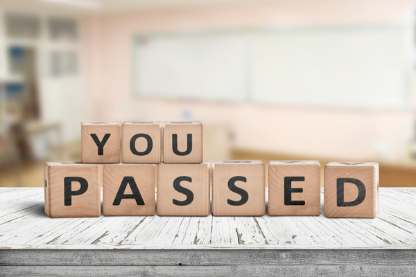 """scrabble tiles spelling """"you passed"""""""