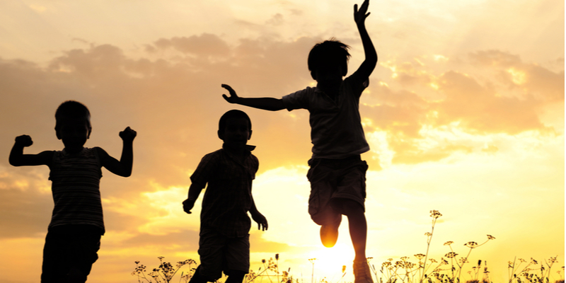 children playing in summer sunset